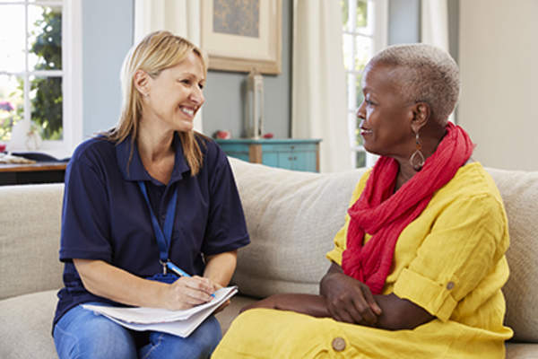 Social worker talking to a senior.