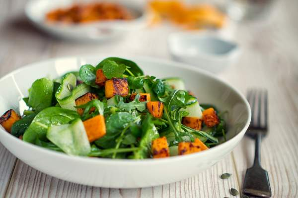 Healthy green salad with roasted butternut squash