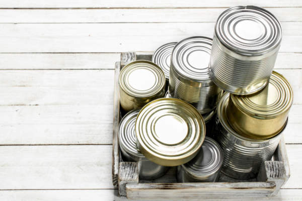 Tin cans with food in a box