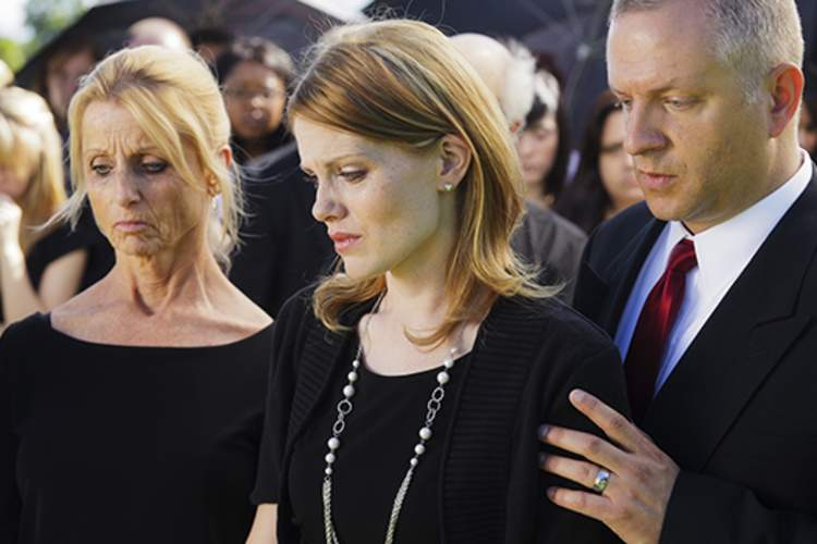 Family grieving at a funeral
