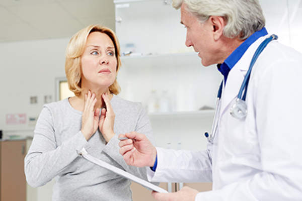 Woman explaining her swollen nymph nodes to a doctor.