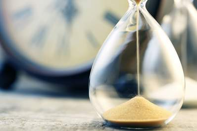 Waiting for the sand in an hourglass to fall.