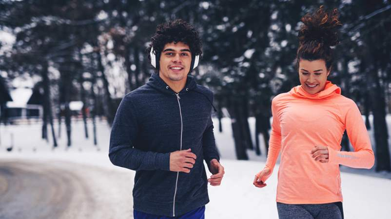 Couple jogging in winter.
