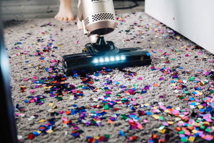 vacuuming up glitter