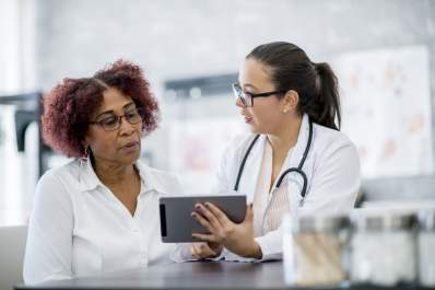 Doctor explaining test results to patient.