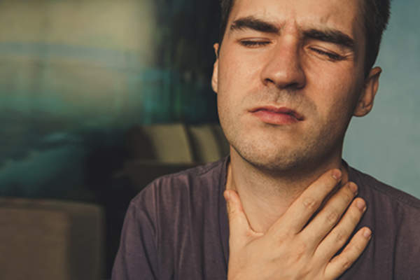 Man with thyroid pain.