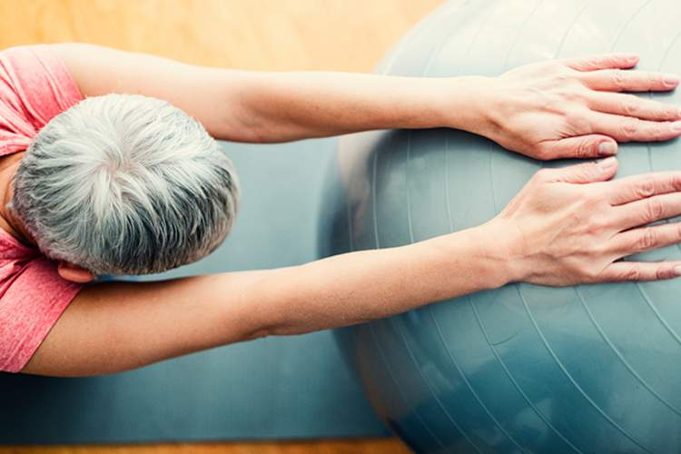 Senior using an exercise ball.