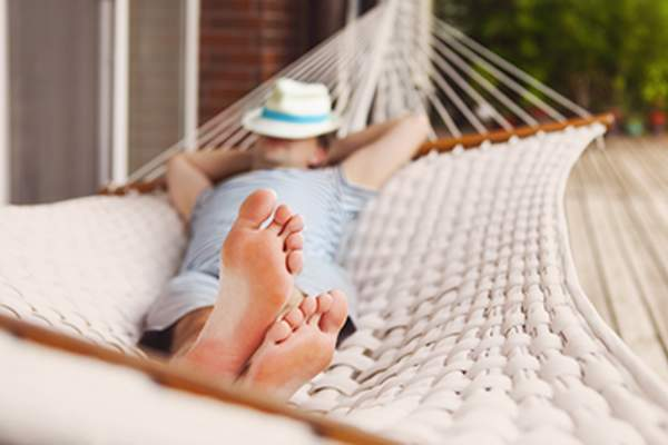 Man relaxing in a hammock.