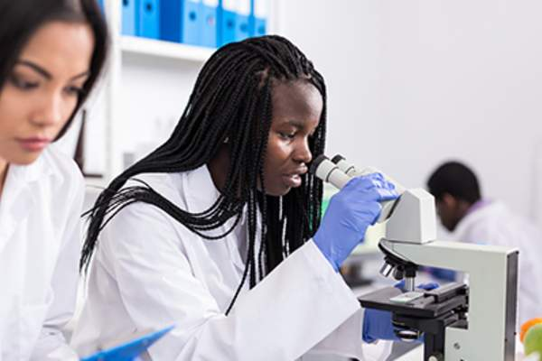 Scientists in medical laboratory.