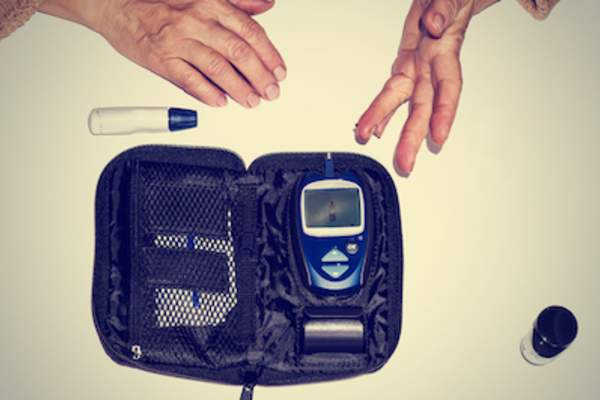 Blood glucose meter with large display screen.