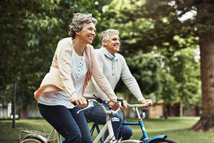 An older couple takes a bike ride together.