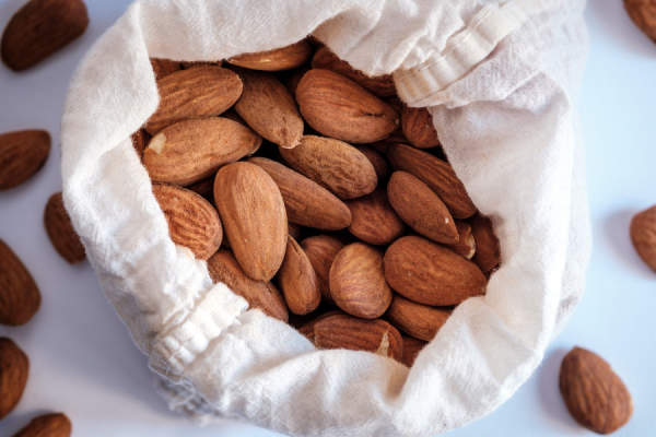almonds in cloth bag