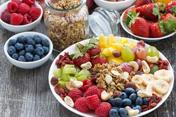 Fruit, grains, healthy food on table.