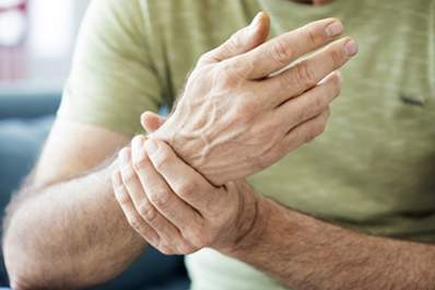 A man with gout has wrist pain.