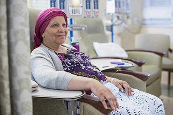 Woman undergoing chemotherapy treatment.