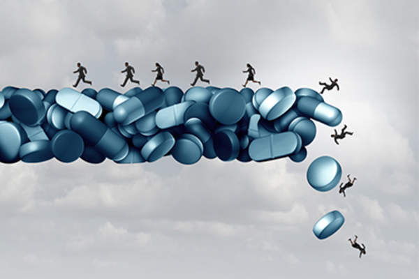 Opioid health risks concept, falling off bridge of pills.