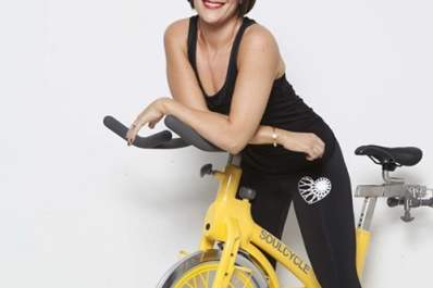 Olivia Ward on a SoulCycle stationary bicycle.