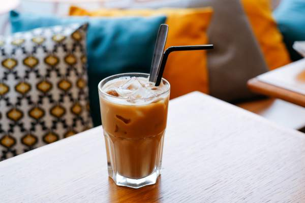 Iced latte with straw