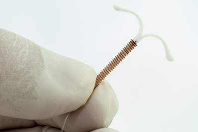 Doctor holding an intrauterine device.