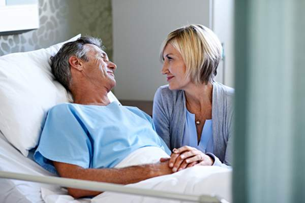 wife visiting husband in hospital image