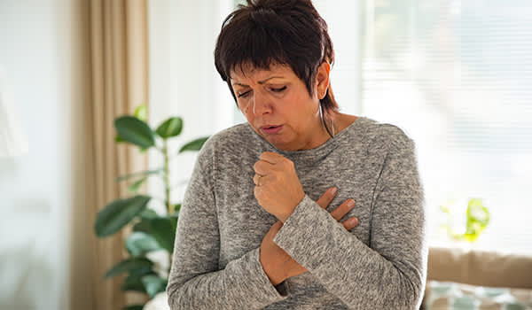 Woman with chest pain coughing.