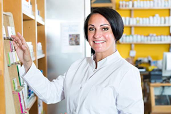 woman pharmacist in storage room image