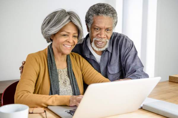 Healthy couple on computer.
