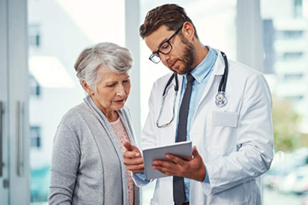 Doctor explaining information to a patient.