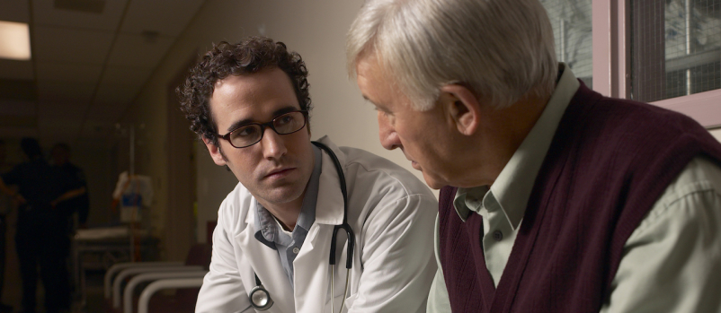 older male talking to doctor