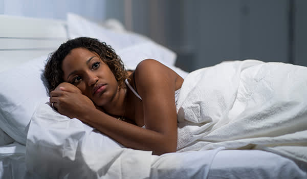 Woman with insomnia can't sleep