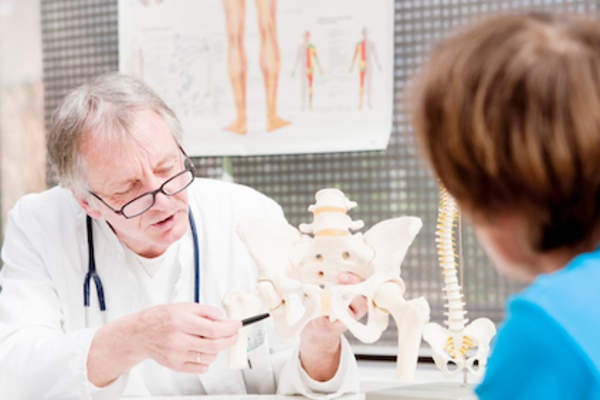 Doctor explaining osteoarthritis to a patient.