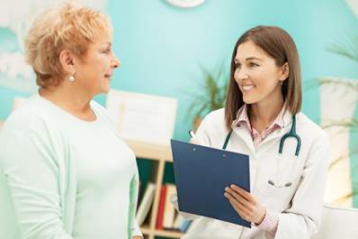 Middle age woman patient talking to a doctor.