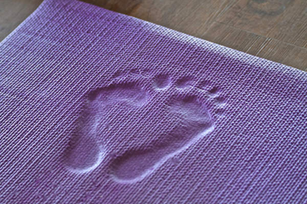 Footprints on a mat.