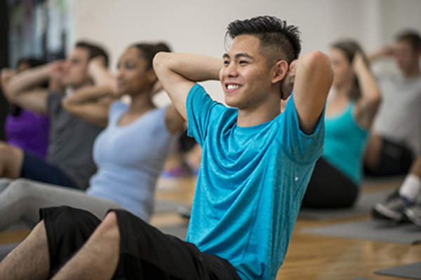 Man doing sit-ups in an exercise class