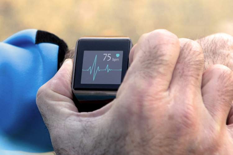 Man using smartwatch, fitness tracker.