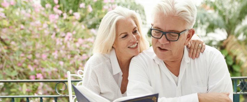man and woman looking at photo album