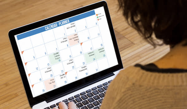 Woman on laptop planning the month.