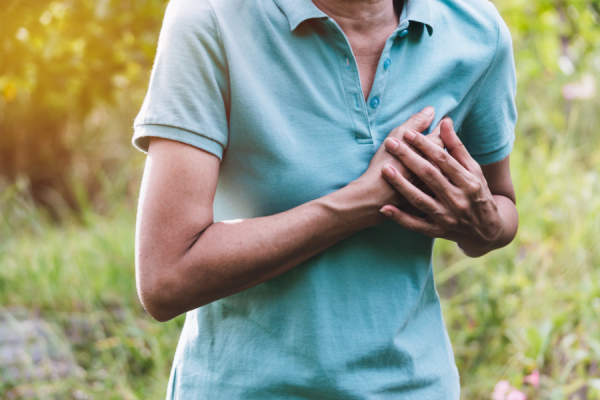 close up of woman clutching heart