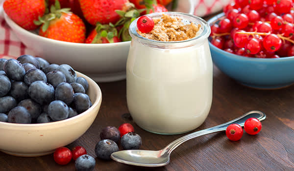 Jar of fresh yogurt, berries and muesli