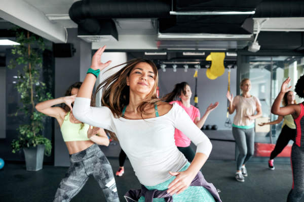Group of women enjoying dance fitness together in the gym