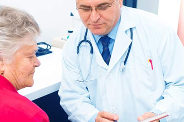 Doctor talking to senior woman patient.