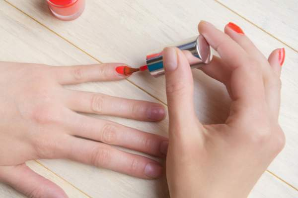 Woman painting her own fingernails.
