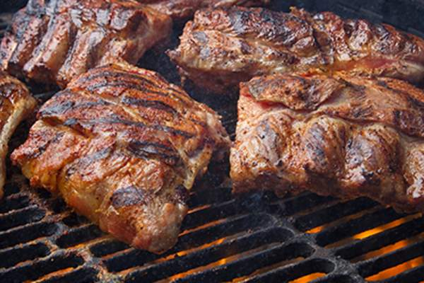 Barbecued meat on grill image.