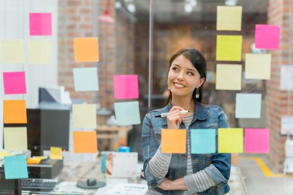 Woman thinking of ideas at the office