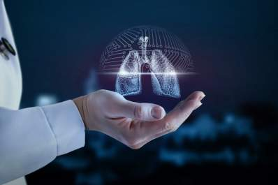 Doctors hand holding digital lungs, lung cancer concept.