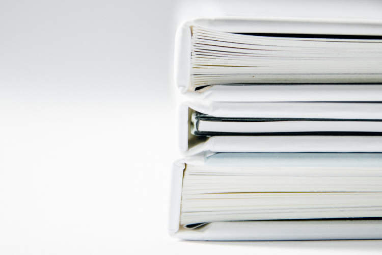 white binders on white background
