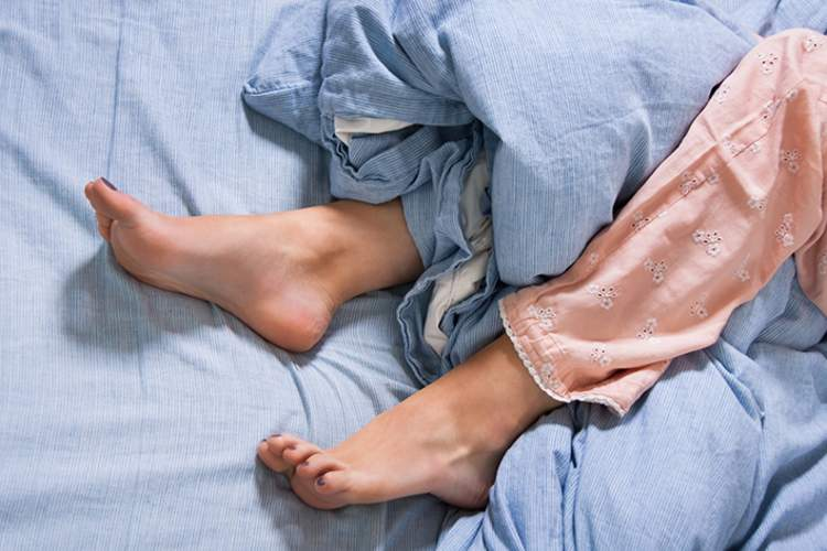 Woman with restless leg syndrome.