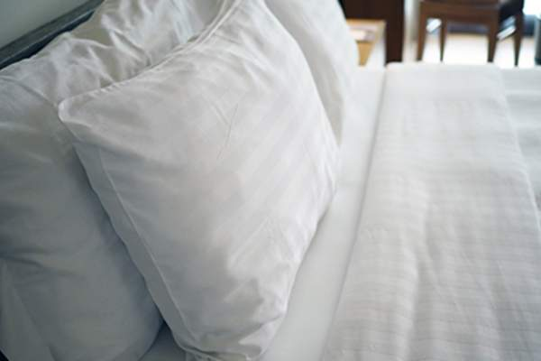 White pillows on a bed.