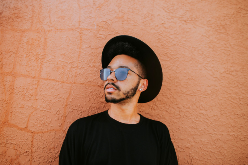 young man wearing hat and sunglasses