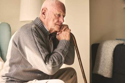 Elderly man alone at home.